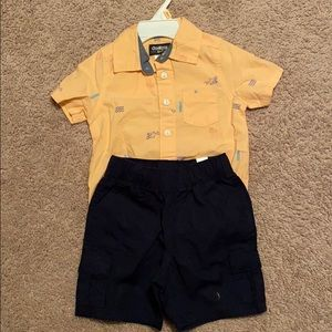 collared shirt sleeve onesie and cargo shorts